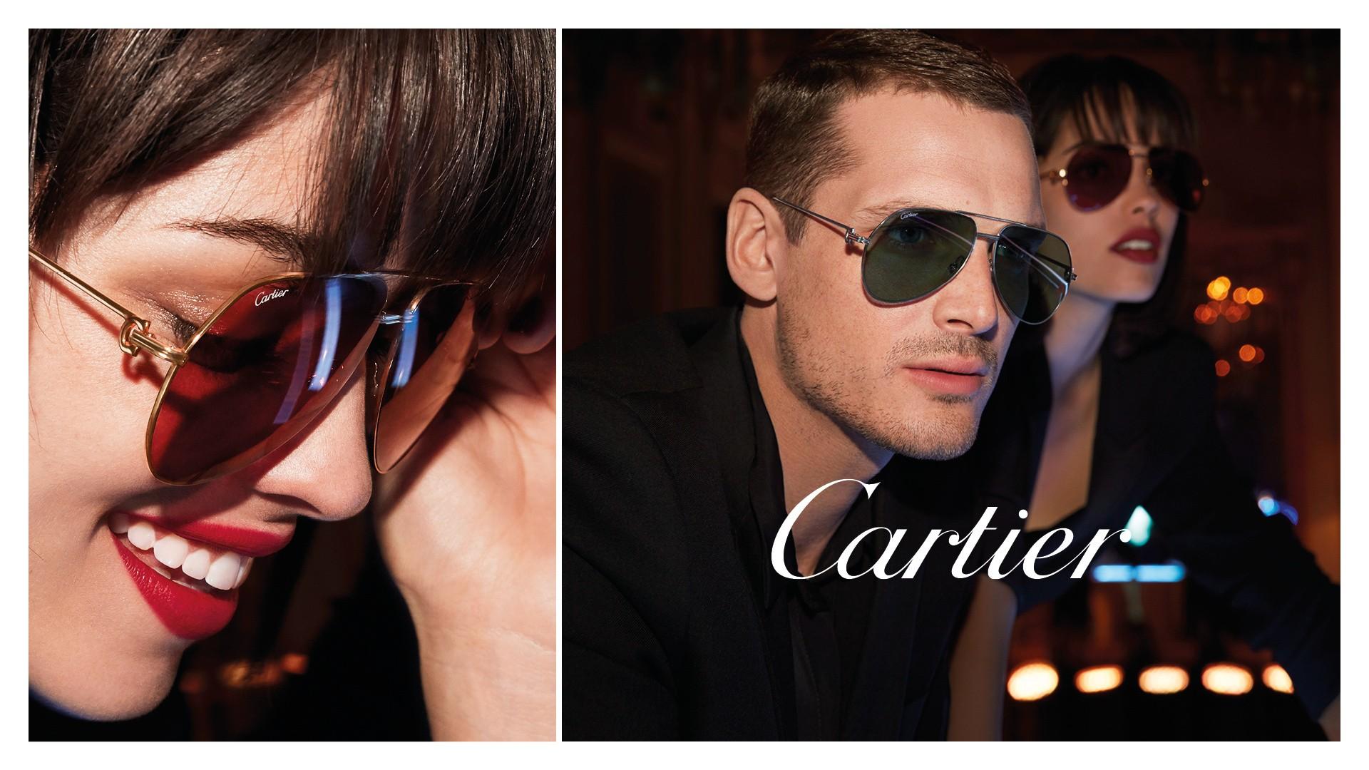 Links eine Nahaufnahme von einer lächelnden Frau mit braunem Pony und einer rot getönten Sonnenbrille und rechts ein Mann mit ernstem Blick und dunkler Cartier Sonnenbrille.