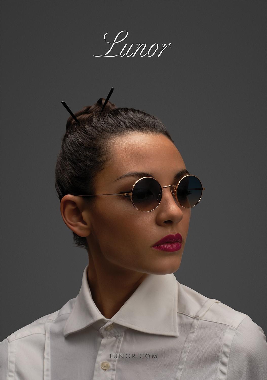 Nahaufnahme von einem Female Model mit braunen Haaren, das eine Lunor Sonnenbrille trägt.