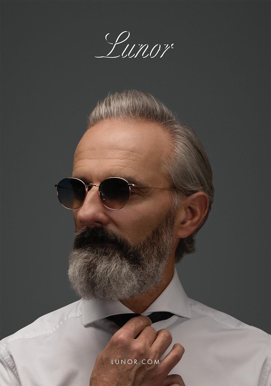 Nahaufnahme von einem älteren Male Model mit Bart, das eine Lunor Sonnenbrille trägt.