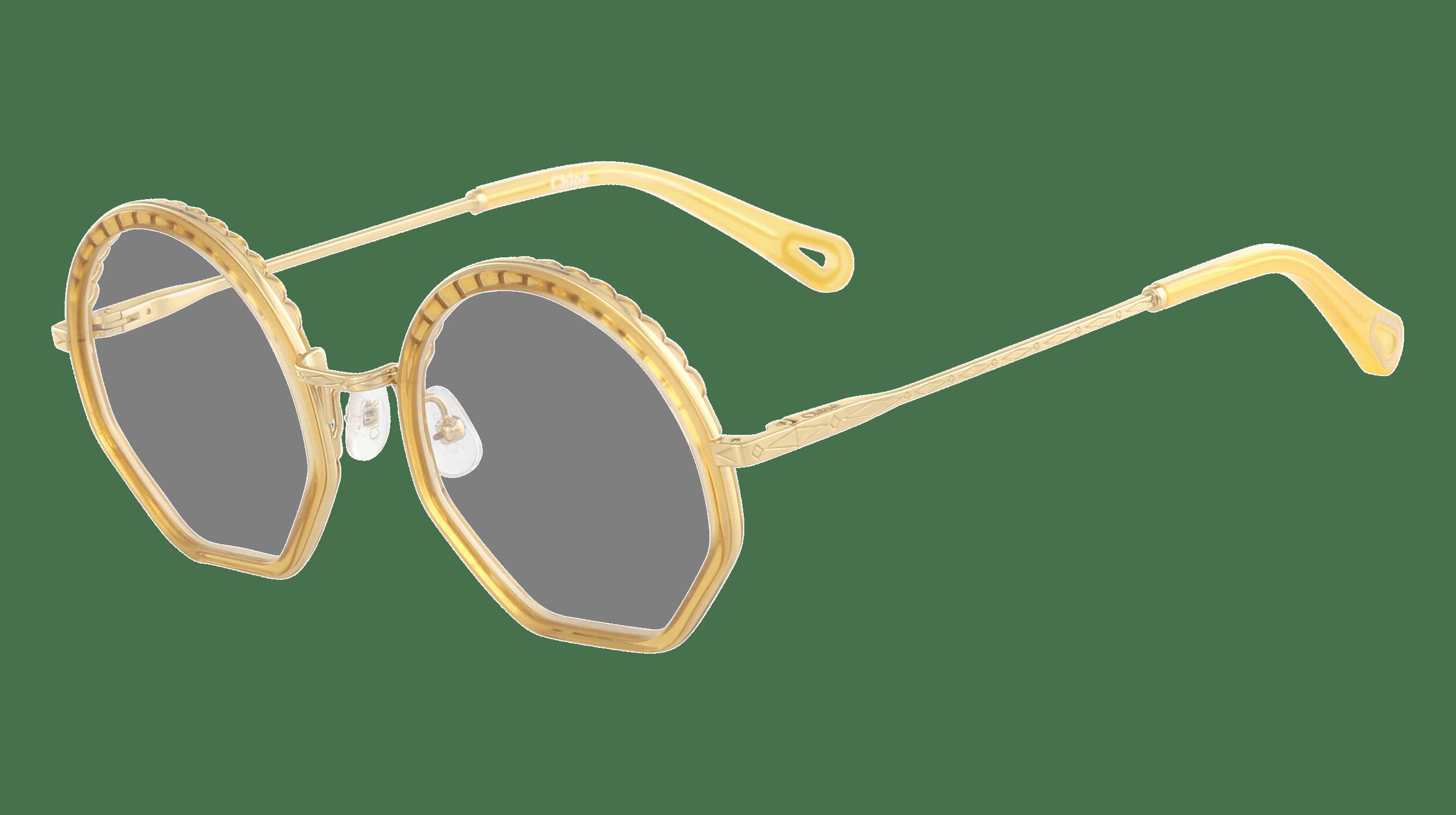 Nahaufnahme von einer Cloé Korrekturbrille mit goldenem Rahmen und Bügeln und runden Brillengläsern.